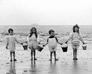 Antique photograph of children at the shore
