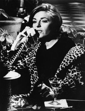 Mrs. Robinson in leopard print coat